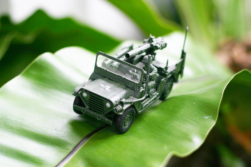 Toy Soldier on a big banana leaf stock photos