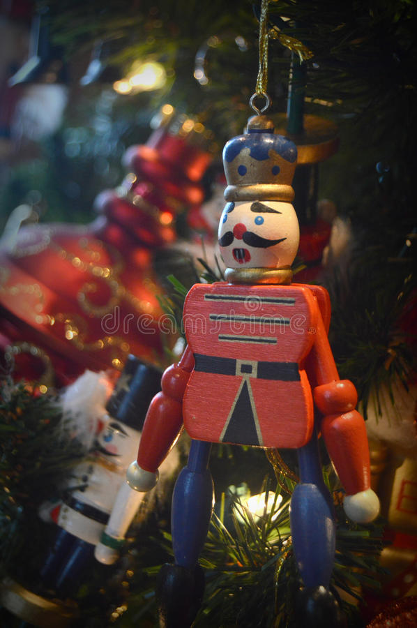 Toy Soldier Christmas Ornament. A toy soldier Christmas tree ornament hanging on a Christmas tree stock image