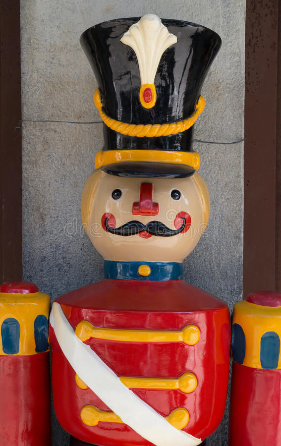 Toy Soldier. Colorful toy soldier standing at attention before concrete and wood structure stock images