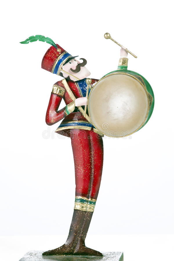 Toy Soldier Drum Player Isolated White. A toy soldier drum player isolated against a white background in the vertical format royalty free stock images