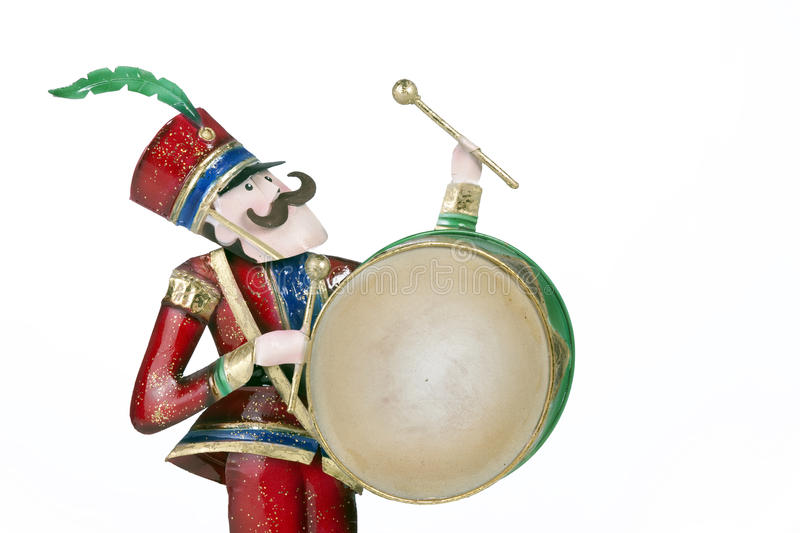 Toy Soldier Playing Drum Isolated White. A toy soldier drum player isolated against a white background in the horizontal format royalty free stock image