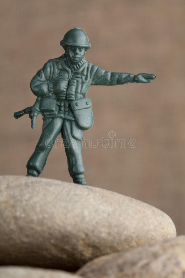 Toy soldier on the rocks stock photos