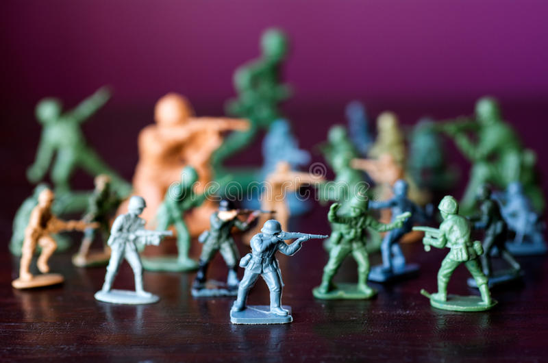 Toy soldiers - world war. Toy soldiers and miniature figurine. Concept photo of world war, conflict and warfare royalty free stock images
