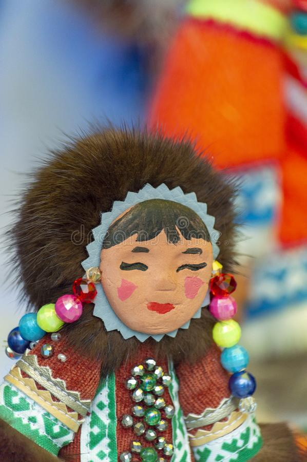 Toy souvenir of a Khanty girl on a city day celebration, royalty free stock images