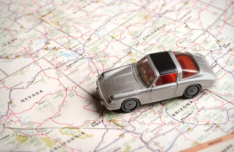 Toy sports car on a road map royalty free stock photo
