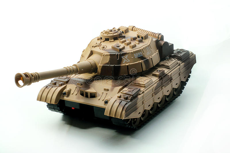 Toy Tank. Image of a plastic toy tank isolated over white stock photography