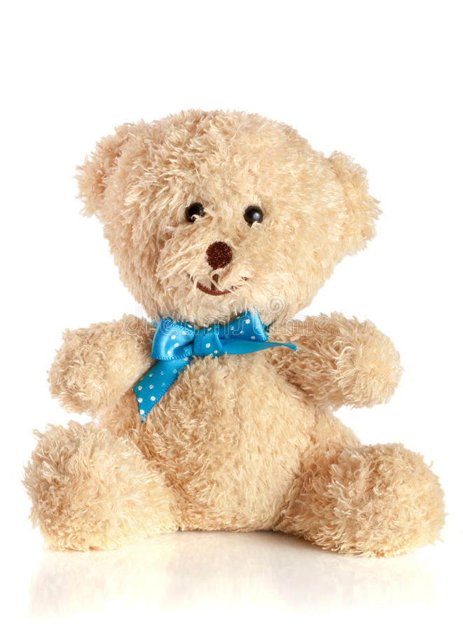 Toy teddy bear with blue bow isolated on white background.  royalty free stock photography