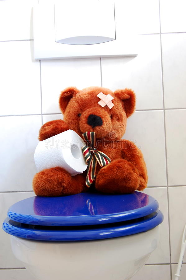 Toy Teddy Bear On Wc Toilet Stock Images