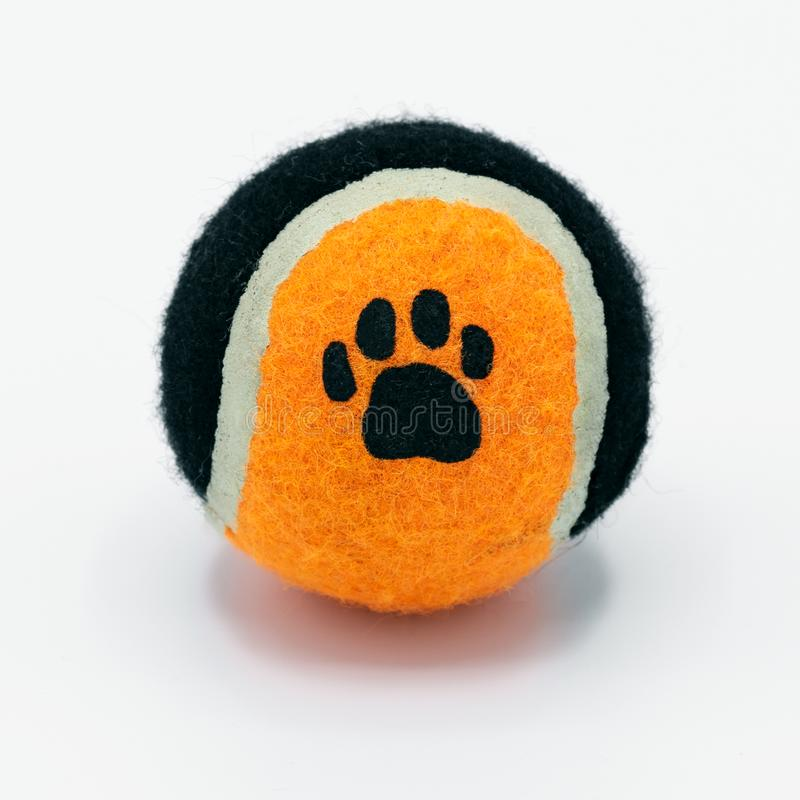 Toy tennis ball for pets on a white background stock photo