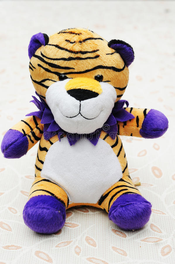 Toy tiger. A small tiger toy on the desk stock photography