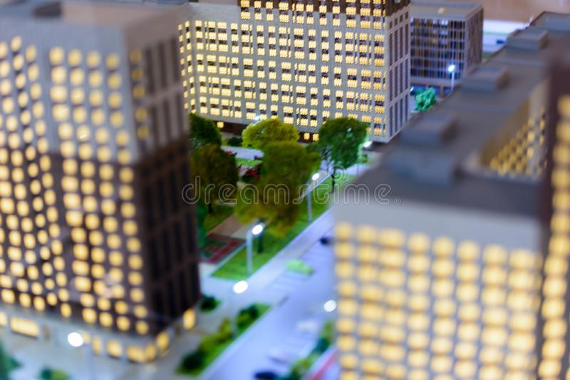 Toy town. Tilt shift blur effect. The cityscape of the housing estate modern skyscrapers. Aerial view stock images