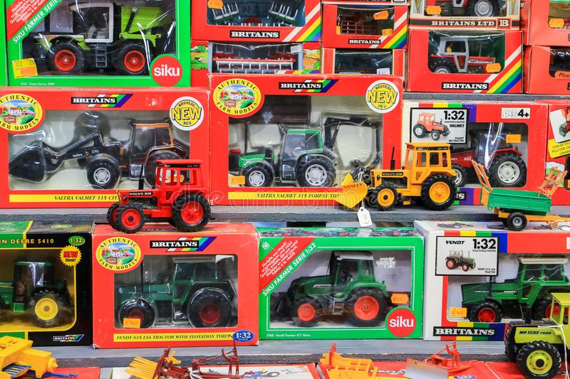Toy tractors for sale in shop. Lots of different toy tractors boxed for sale in rows at country show stock photo