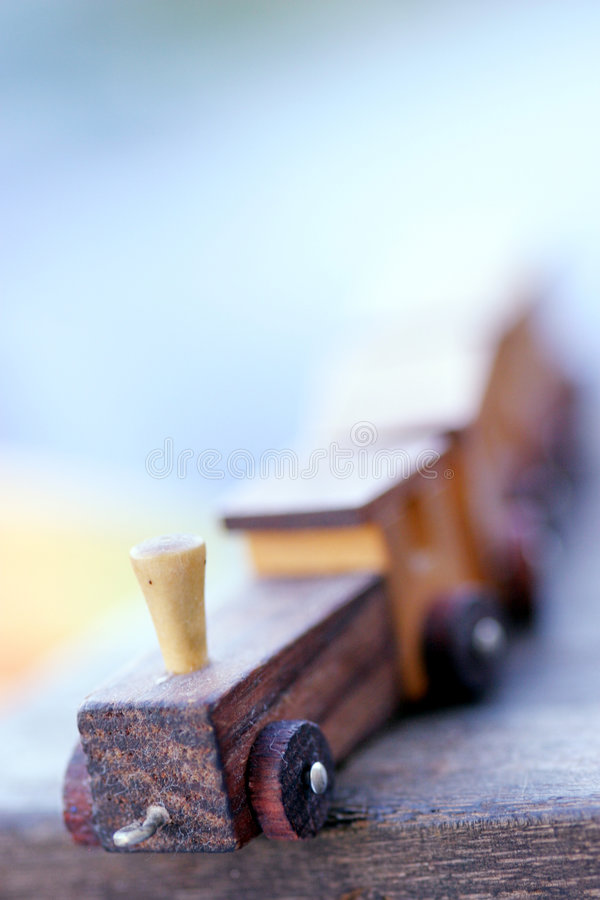 Toy train. Small wooden toy train: focus on the front part, rest out of focus royalty free stock photo