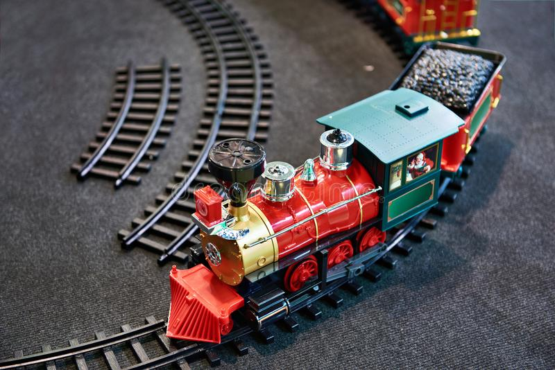 Toy train and childrens railway. Toy train and plastic childrens railway stock image