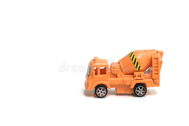 Toy truck concrete mixer vehicle machine cement mixer children toy isolated on white background.  royalty free stock image