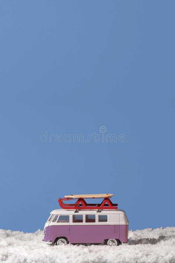 Toy VW Van with Sled in the Snow stock images
