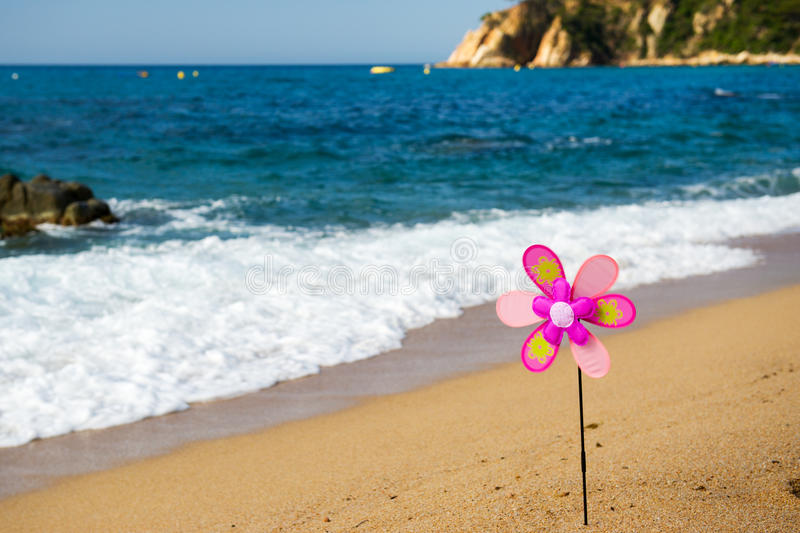 Download Toy wind mill at the beach stock image. Image of trees - 32873775