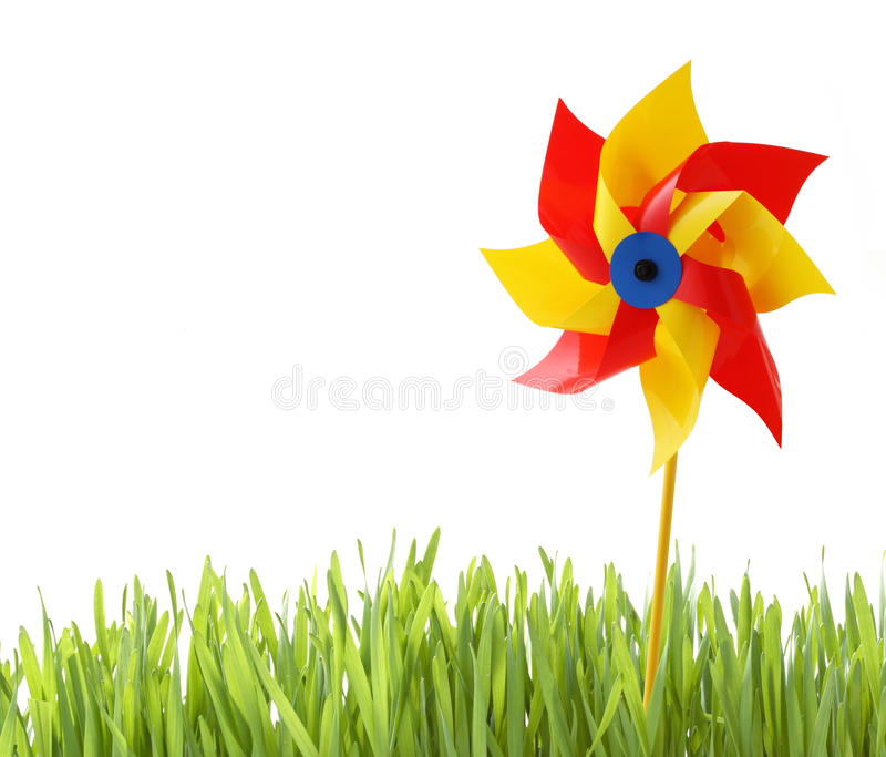 Toy windmill and grass isolated-