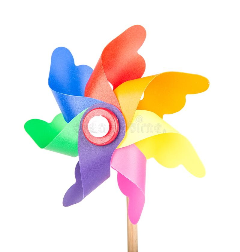 Toy windmill propeller with color blades. Isolated royalty free stock images