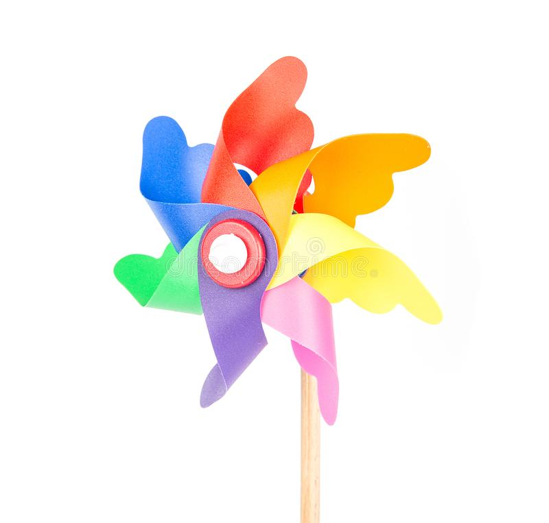 Toy windmill propeller with color blades. Isolated stock photos