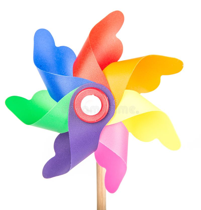 Toy windmill propeller with color blades. Isolated royalty free stock photo