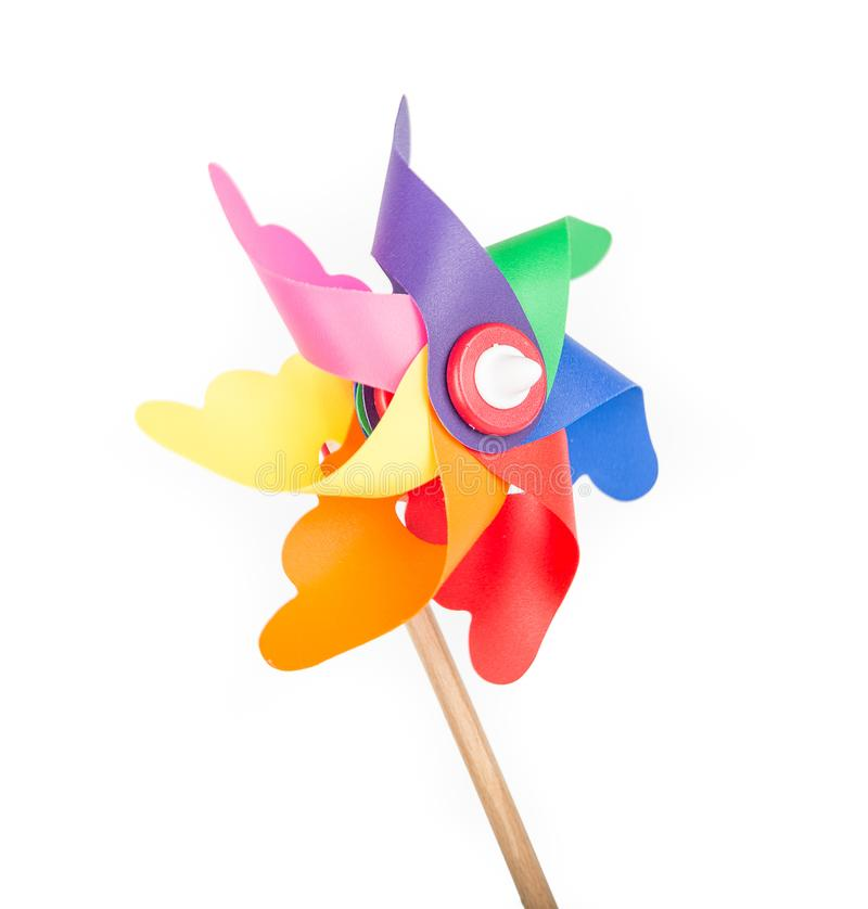 Toy windmill propeller with color blades. Isolated royalty free stock photos