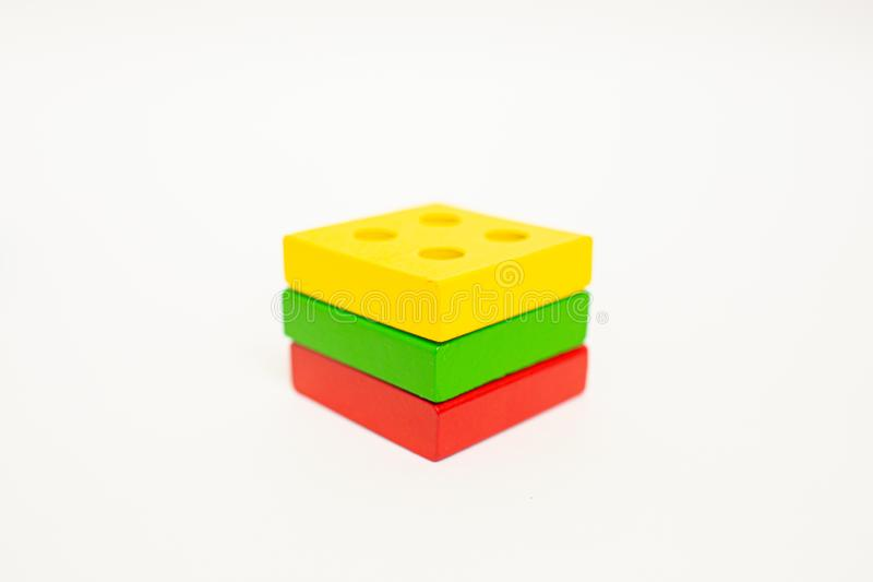 Toy wooden blocks, multicolor building construction bricks Lithuania flag. White background. Early education. Toy wooden blocks, multicolor building construction royalty free stock photos