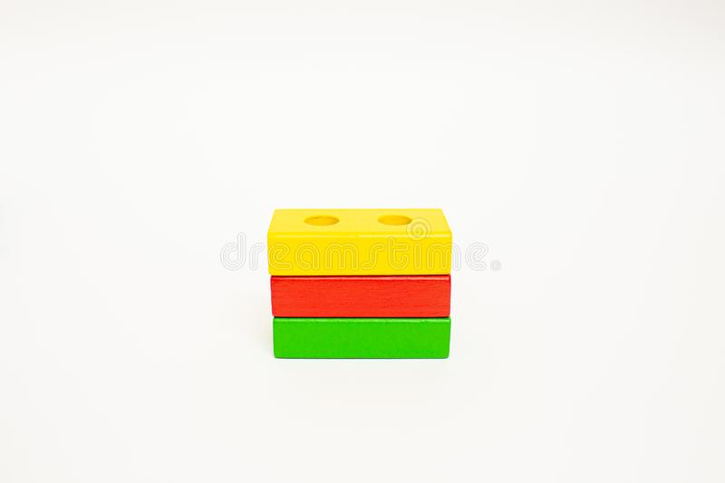Toy wooden blocks, multicolor building construction bricks Lithuania flag. White background. Early education. Toy wooden blocks, multicolor building construction stock photo