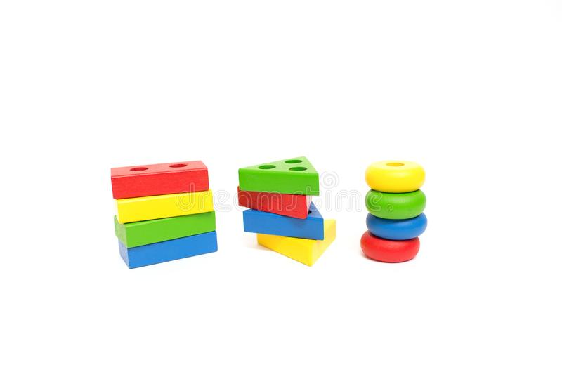 Toy wooden blocks, multicolor building construction bricks over white background. Early education concept royalty free stock image