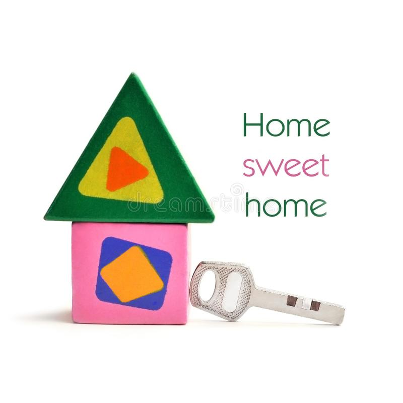 Toy, wooden, colored house with key royalty free stock images