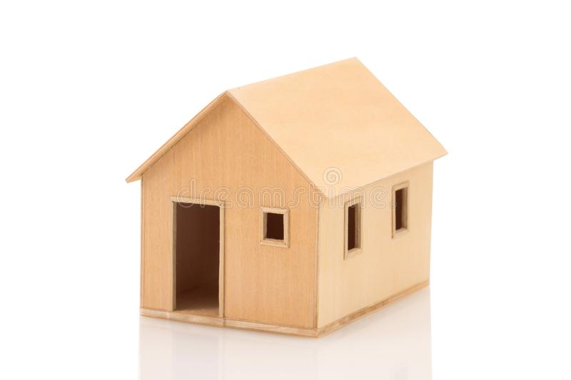 Toy wooden house model on white background royalty free stock photos