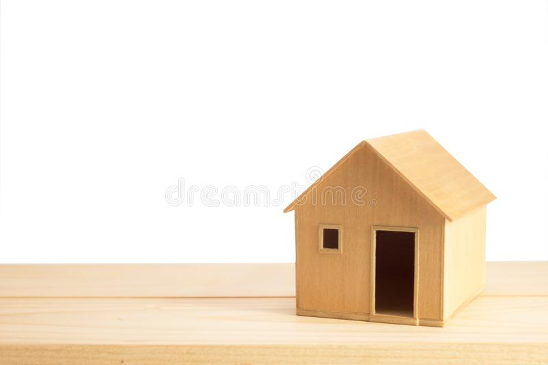 Toy wooden house model on white stock photo