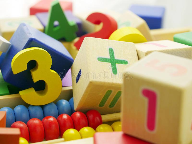 Toy wooden numbers stock photography