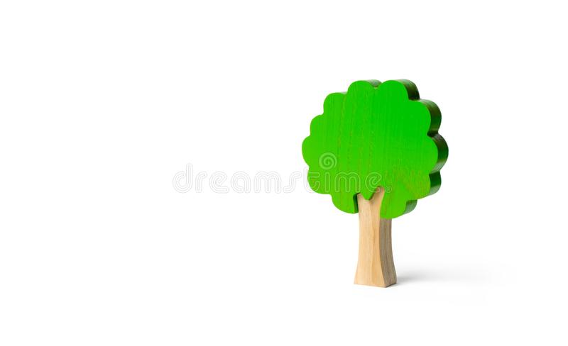 Toy wooden tree on an isolated background. Minimalism and the concept of environmental conservation. lungs of the planet. Family. Tree, a symbol of strength and royalty free stock images