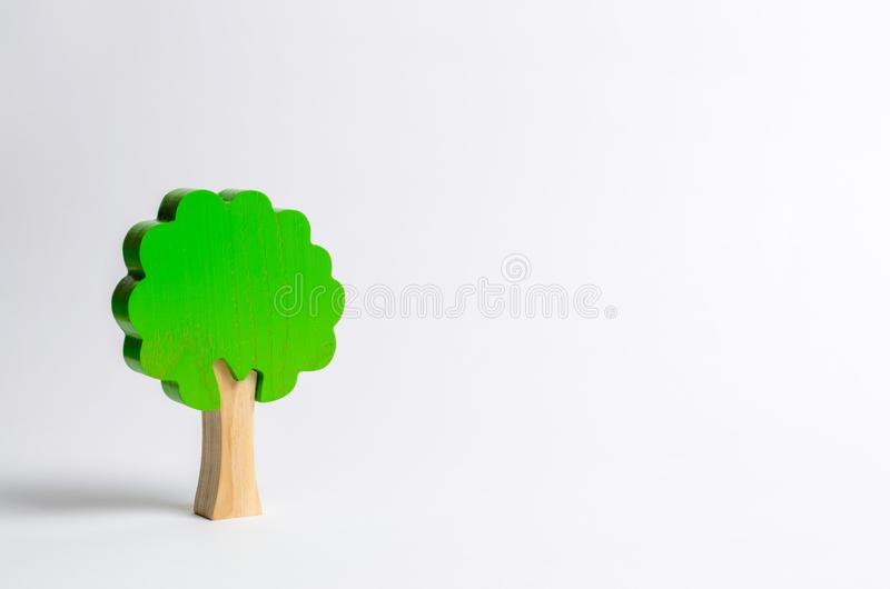 Toy wooden tree on a white background. Minimalism and the concept of environmental conservation. lungs of the planet. Family tree royalty free stock photography