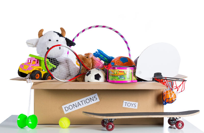 Toybox to donate. Box of assorted toys to donate with white background stock images