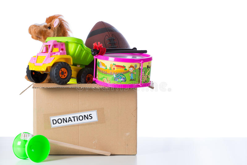 Toybox to donate. Box of assorted toys to donate with white background royalty free stock photos