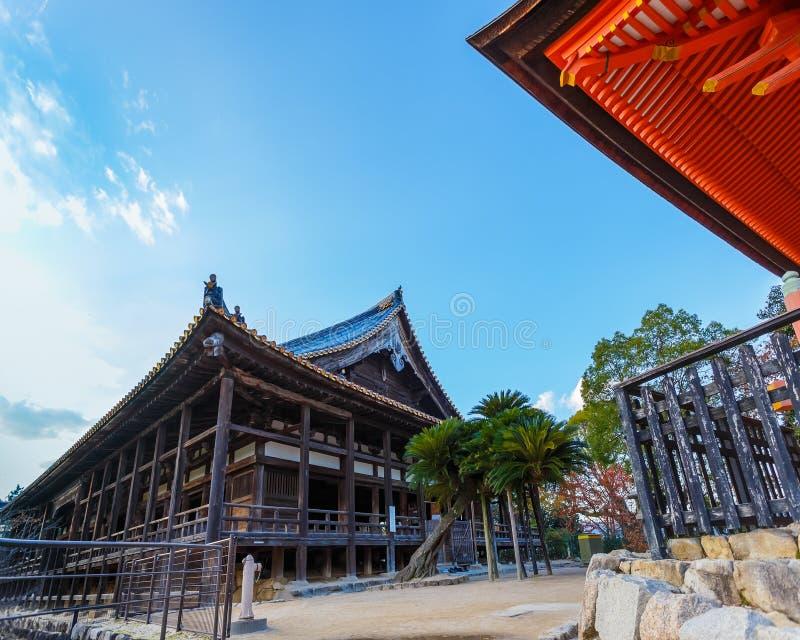 Toyokuni Shrine in Miyajima. MIYAJIMA, JAPAN - NOVEMBER 15: Toyokuni Shrine in Miyajima, Japan on November 15, 2013. The wood structure called Senjokaku (Hall of royalty free stock images