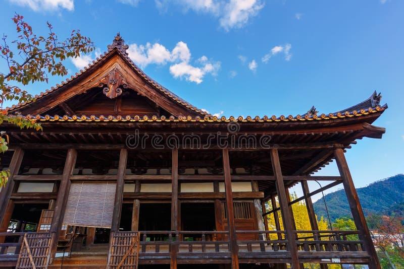 Toyokuni Shrine in Miyajima. The wood structure called Senjokaku (Hall of 1000 Tatami) reflecting the largest structure on Miyajima stock image