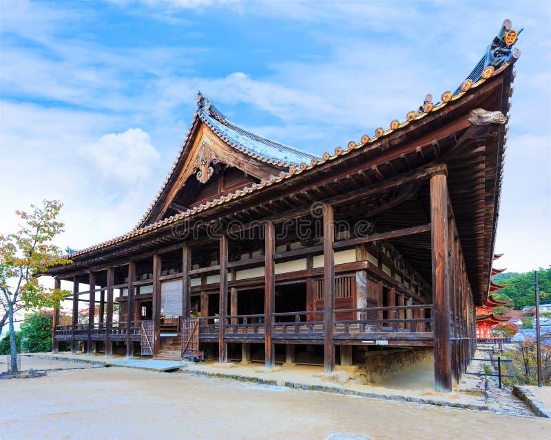 Toyokuni Shrine in Miyajima. The wood structure called Senjokaku (Hall of 1000 Tatami) reflecting the largest structure on Miyajima royalty free stock images