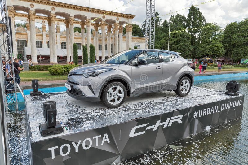 Toyota C-HR hybrid crossover in National Expocenter. Kiev, Ukraine. Promotional booth with new Toyota C-HR modern design hybrid crossover in the fountain at the royalty free stock images