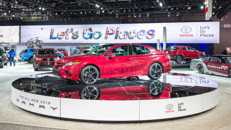 2018 Toyota Camry. DETROIT, MI/USA - JANUARY 12, 2017: A custodian polishes a car near a 2018 Toyota Camry at the North American International Auto Show NAIAS stock photos