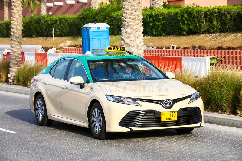 Toyota Camry. Dubai, UAE - November 16, 2018: Taxi car Toyota Camry in the city street royalty free stock photo