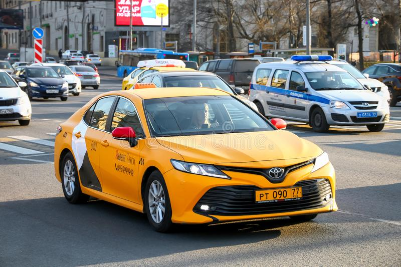 Toyota Camry. Moscow, Russia - April 19, 2019: Taxi car Toyota Camry in the city street stock image
