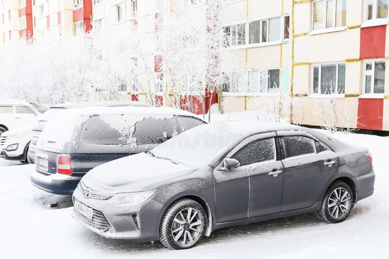 Toyota Camry. Novyy Urengoy, Russia - January 26, 2019: Motor car Toyota Camry covered with snow in the city street stock photography