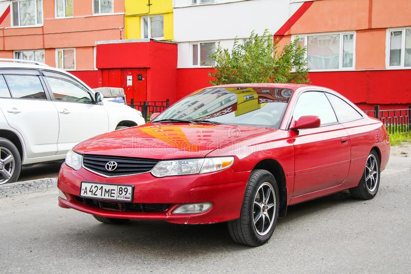 Toyota Camry Solara. Novyy Urengoy, Russia - August 31, 2012: Red motor car Toyota Camry Solara in the city street royalty free stock images