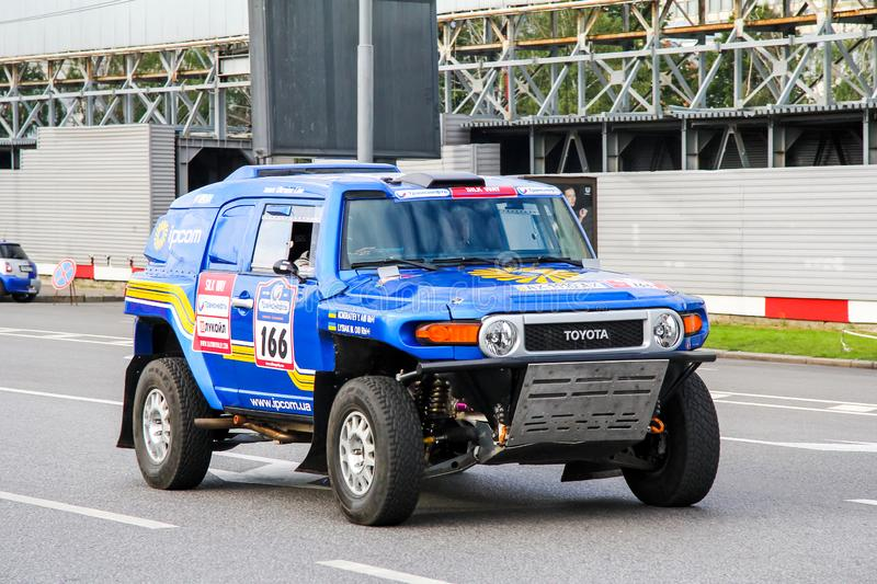 Toyota FJ Cruiser. Moscow, Russia - July 7, 2012: Mikhail Lisyak`s rally car Toyota FJ Cruiser takes part in the annual rally Silk Way 2012 royalty free stock photo