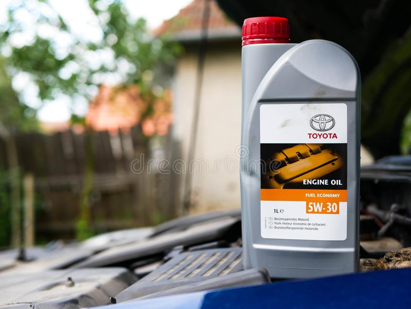 Toyota 5W 30 engine oil on opened engine hood. Miercurea Ciuc, Romania- 12 July 2019: Toyota 5W 30 engine oil on opened engine hood stock photography
