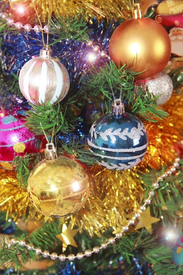 Toys balls on the Christmas tree for the new year holiday. Toys balls on the Christmas tree for the new year a holiday stock image