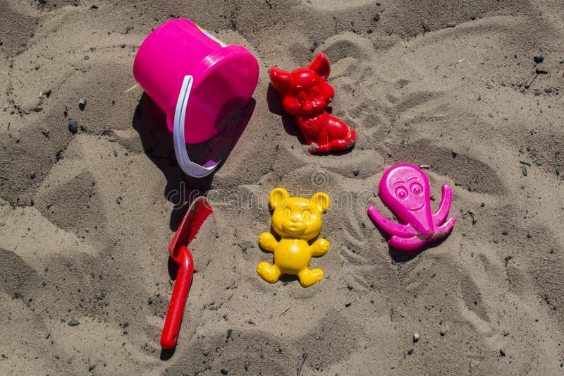 Toys on the beach. Toys and sand - exactly what is needed for summer stock image